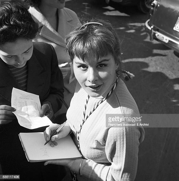 Italian actors Marisa Allasio signing an autograph at the Cinema Rally 1956