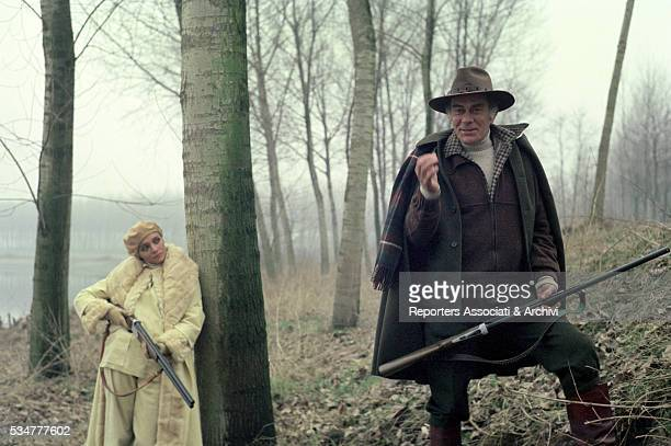 Italian actors Massimo Serato and Mara Venier hunting in the woods in the film Evil Thoughts 1976