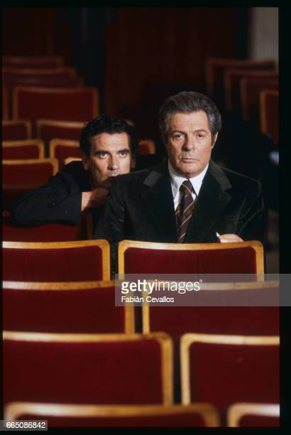 Italian actors Massimo Troisi and Marcello Mastroianni sit in theater seats on the set of the movie Splendor directed by Italian director Ettore...