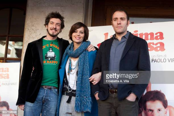 Italian actors Paolo Ruffini Claudia Pandolfi and Valerio Mastandrea attend 'La Prima Cosa Bella' photocall at Embassy Cinema on January 12 2010 in...