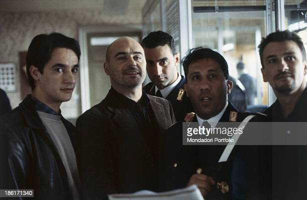 Italian actors Peppino Mazzotta Angelo Russo Davide Lo Verde and Luca Zingaretti standing at the police station in the TV miniseries Inspector...
