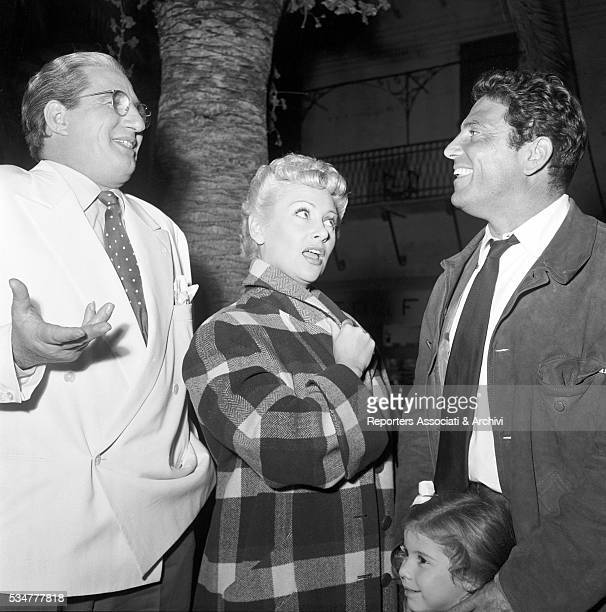 Italian actors Raf Vallone and Mario Carotenuto posing with French actress Martine Carol on the set of The Beach Italy 1953