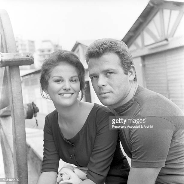 Italian actors Renato Salvatori and Claudia Cardinale relaxing during a break on the set of the film Fiasco in Milan 1959
