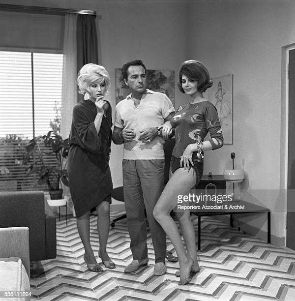 Italian actors Rossano Brazzi Sylva Koscina and Monica Vitti in the segment La lepre e la tartaruga from the film Three Fables of Love 1962