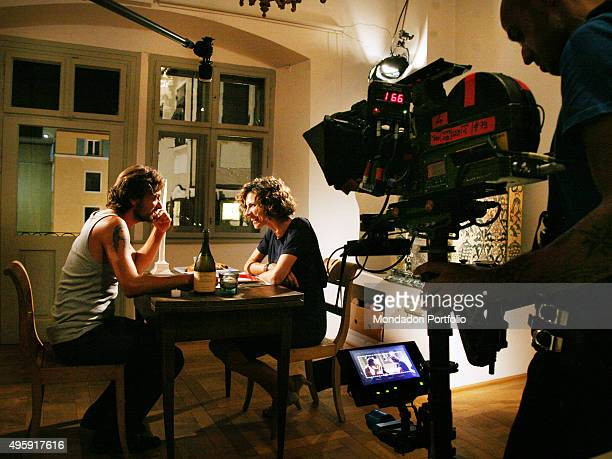 Italian actors Sergio Assisi and Chiara Ricci reciting sitting at the laid table Photo shoot realized on the set of 'Una coppia modello' the second...