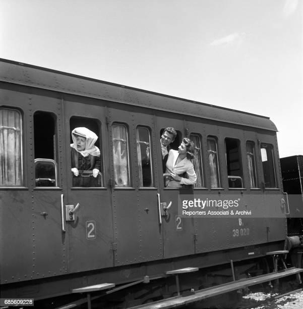 Italian actors Tina Pica Renato Salvatori and Sylva Koscina on a train in La nonna Sabella 1957