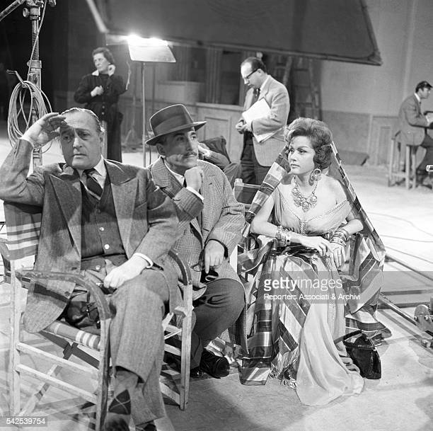 Italian actors Totò and Peppino De Filippo and Romenian actress Nadia Gray on the set of Letto a tre piazze 1960