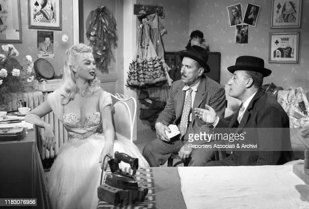 Italian actors Totò and Peppino De Filippo talking to Italian actress Dorian Gray in the film Totò Peppino and the Hussy 1956