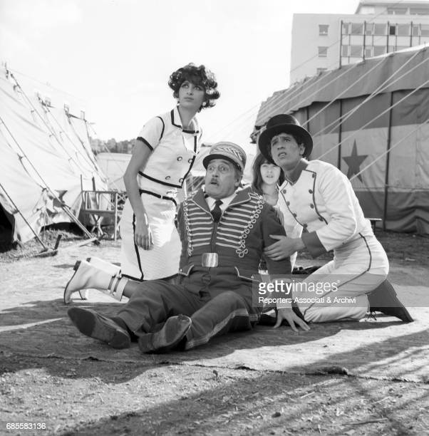 Italian actors Tot• Ninetto Davoli Femi Benussi as circus artists in the film The Hawks and the Sparrows directed by Pier Paolo Pasolini comedy Italy...