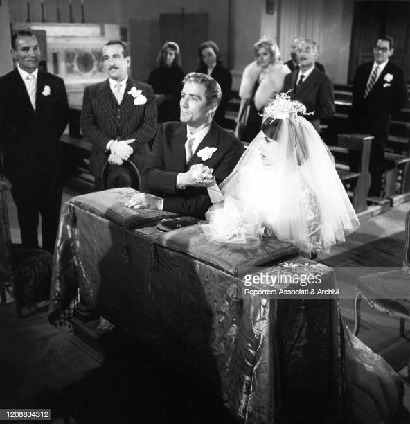 Italian actors Vittorio Gassman and Anna Maria Ferrero getting married in the film Love and Larceny. Beside them, Italian actor Peppino De Filippo....