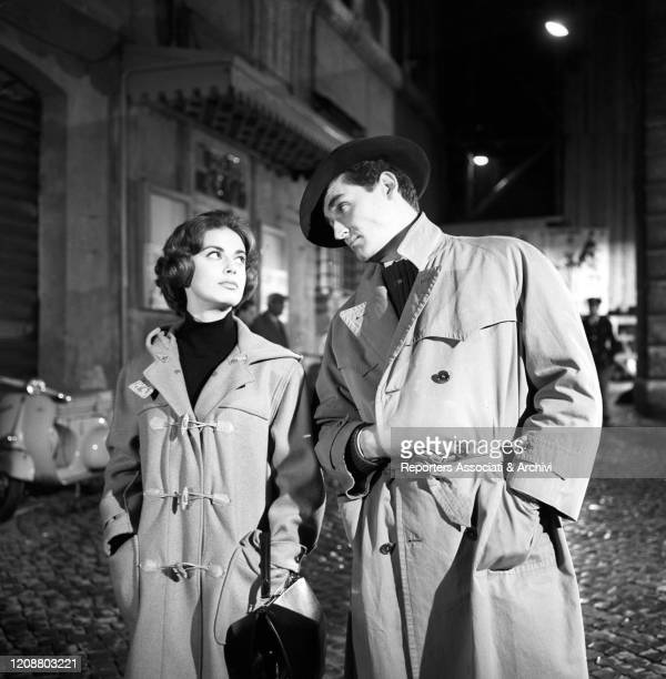 Italian actors Vittorio Gassman and Anna Maria Ferrero looking into each other eyes and walking in the film Love and Larceny. Italy, 4th November 1959