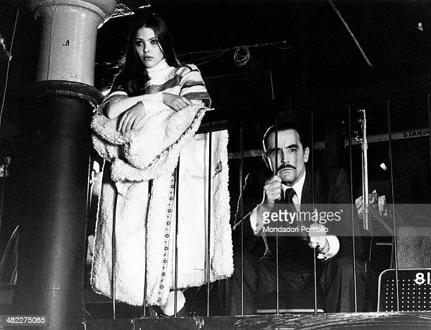 Italian actors Vittorio Gassman and Ornella Muti leaning against a parapet in the film Pure as a Lily 1976