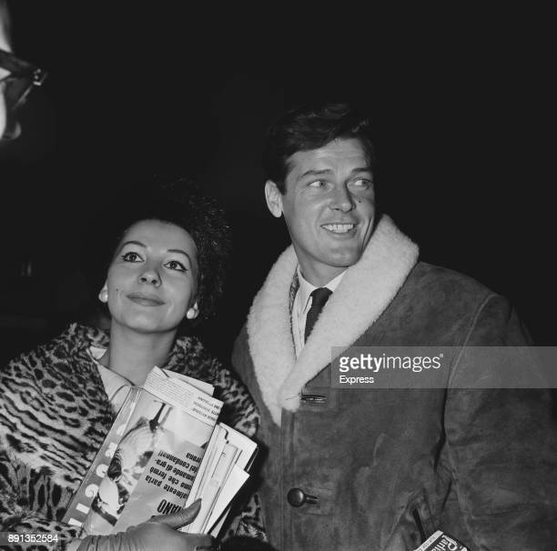 Italian actres Luisa Mattioli and British actor Roger Moore at Heathrow Airport London UK 21st January 1963