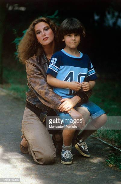 Italian actres Stefania Sandrelli keeps on her knees little Vito the son she had with her husband Roman entrepreneur Nicky Pende Italy 1980