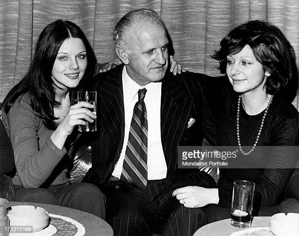 Italian actress Agostina Belli having a drink with her father Domenico Magnoni and her sister Armida Magnoni Milan 1973