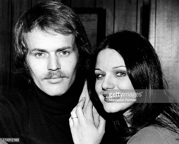 Italian actress Agostina Belli smiling keeping her hands on the shoulder of her partner and Norwegian actor Fred Robsahm Milan 1973