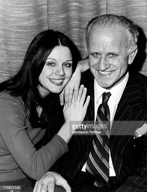 Italian actress Agostina Belli smiling leaning on the shoulder of her father Domenico Magnoni Milan 1973