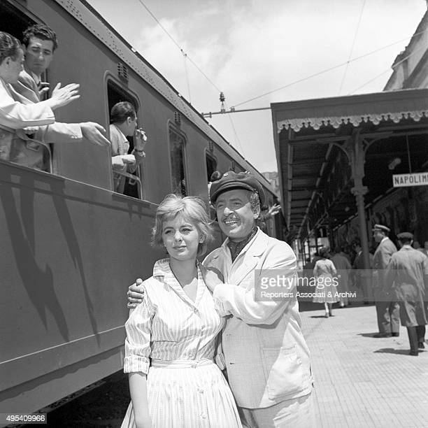 Italian actress Alessandra Panaro and Italian comedian and actor Nino Taranto hugging each other at the railway station in the film Avventura a Capri...
