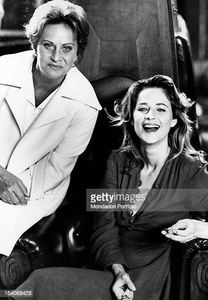 Italian actress Alida Valli and British actress Charlotte Rampling sitting in an armchair and having a break during the shooting of Flesh of the...