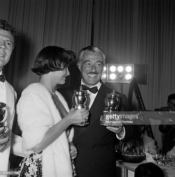 Italian actress Alida Valli and Italian actor and director Vittorio De Sica smiling and posing with the prizes that they won on the occasion of...