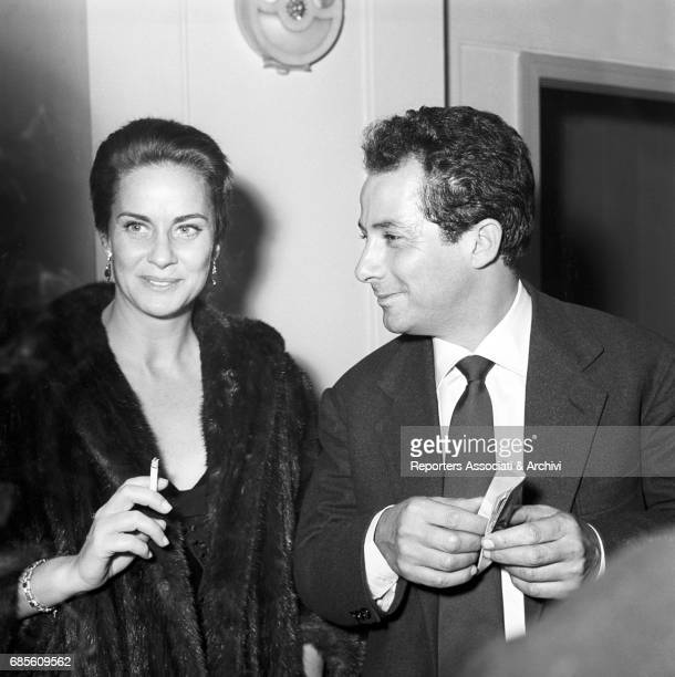 Italian actress Alida Valli and Italian director Gillo Pontecorvo at a cocktail 1956