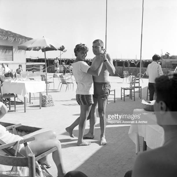 Italian actress Alida Valli and Italian screenwriter Federico Zardi dancing in the beach resort Calypso Torvaianica 1960s