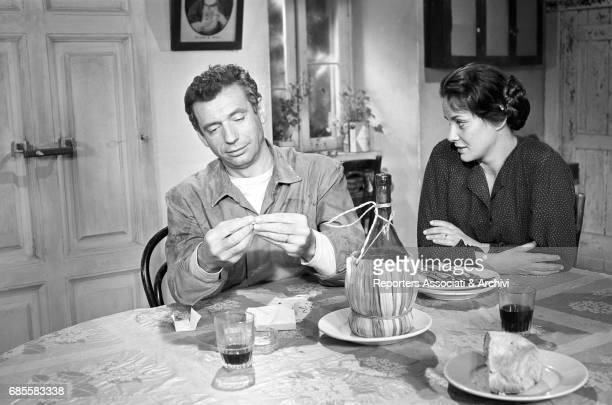 Italian actress Alida Valli and Italianborn French actor and singer Yves Montand in a scene from The Wide Blue Road directed by Gillo Pontecorvo...