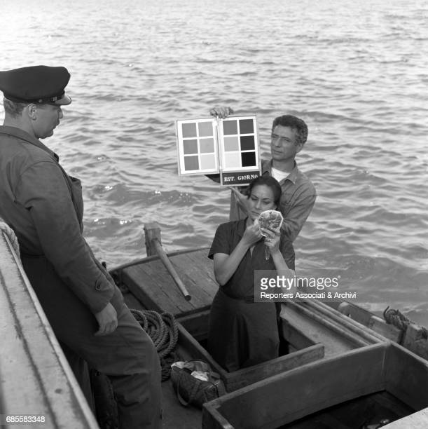 Italian actress Alida Valli and Italianborn French actor and singer Yves Montand on boat during a break on the set of 'The Wide Blue Road' directed...