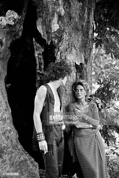 'Italian actress Alida Valli born Alida Maria von Altenburger von Markenstein und Frauenberg leans against a tree beside her son Carlo who has...