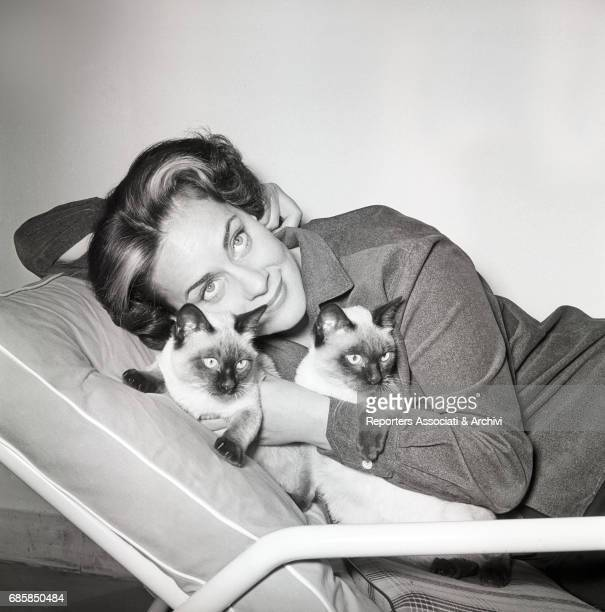 Italian actress Alida Valli cuddling cats in her house 1957