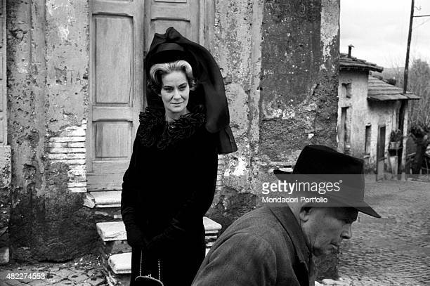 Italian actress Alida Valli dressed in mourning and looking at an old man in the film Umorismo in nero Italy 1964