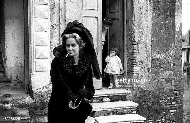 Italian actress Alida Valli dressed in mourning and smoking a cigarette in the film Umorismo in nero Italy 1964