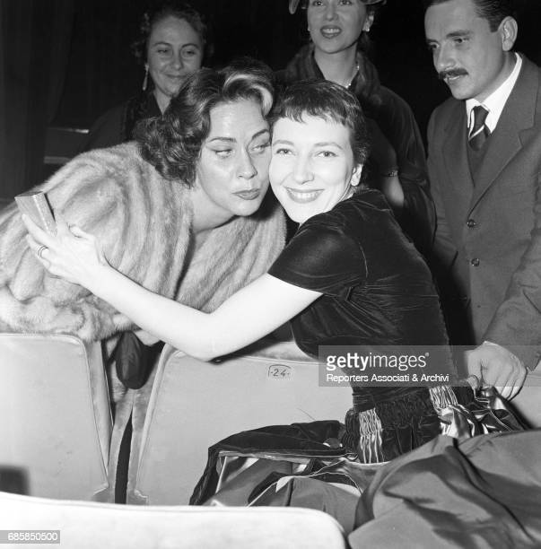Italian actress Alida Valli kissing Italian actress Valentina Cortese at Teatro Quirino for the premiere of Otello Rome 2 November 1956