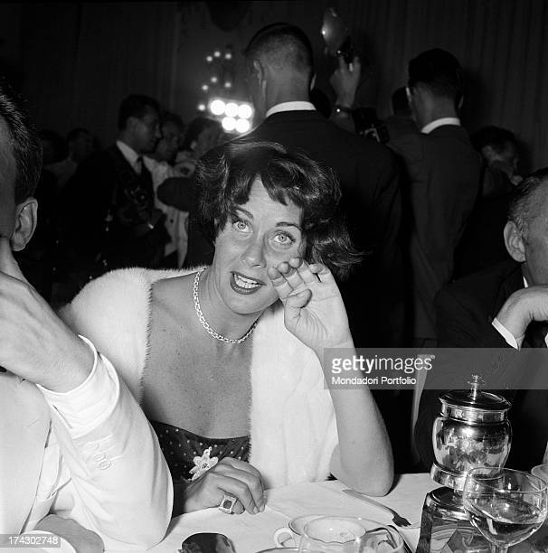 Italian actress Alida Valli sitting at the restaurant with a cup on the table on the occasion of Grolla d'Oro Prize 1955 SaintVincent July 1955