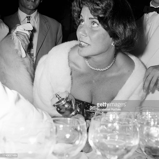 Italian actress Alida Valli sitting at the table on the occasion of Grolla d'Oro Prize 1955 SaintVincent July 1955