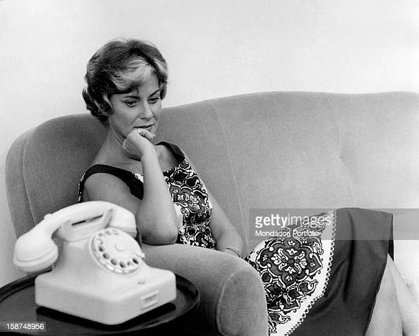 Italian actress Alida Valli sitting on the couch beside a telephone Rome 24th November 1961