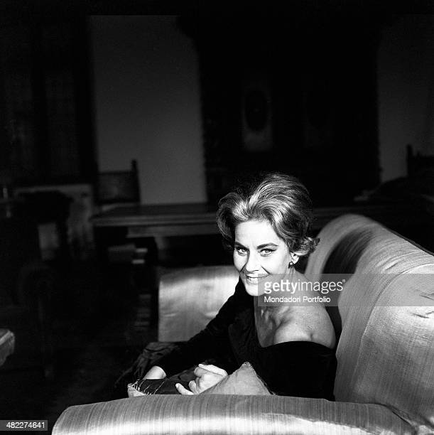 Italian actress Alida Valli smiling seated on a sofa Italy 1960s