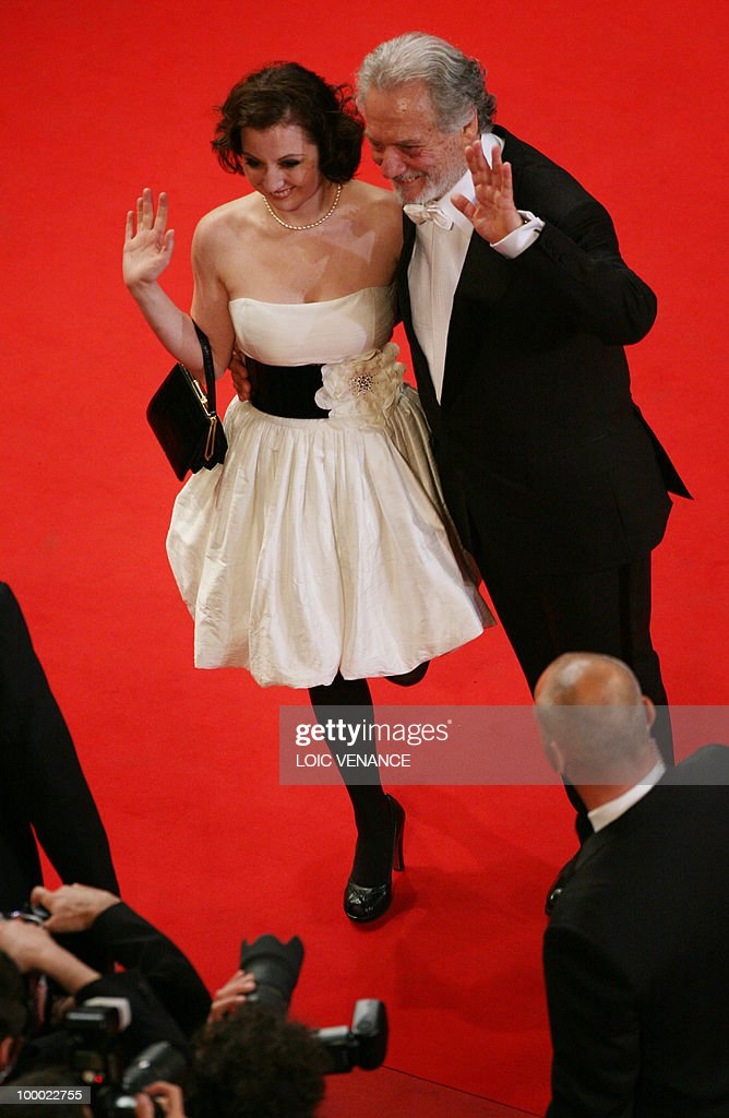 Italian actress Alina Berzenteanu and Italian actor Giorgio Colangeli arrive for the screening of 'La Nostra Vita' (Our Life) presented in competition at the 63rd Cannes Film Festival on May 20, 2010 in Cannes.