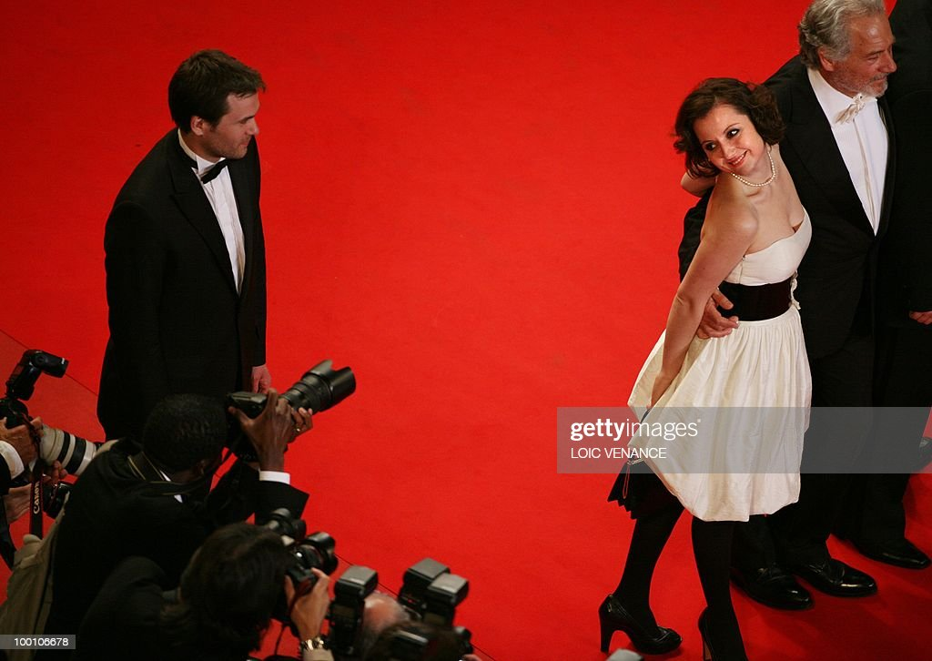 Italian actress Alina Berzenteanu and Italian actor Giorgio Colangeli (R) arrive for the screening of 'La Nostra Vita' (Our Life) presented in competition at the 63rd Cannes Film Festival on May 20, 2010 in Cannes.