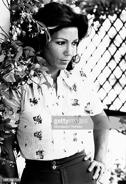 Italian actress and dubber Maria Fiore posing near a jasmine plant Rome 1974