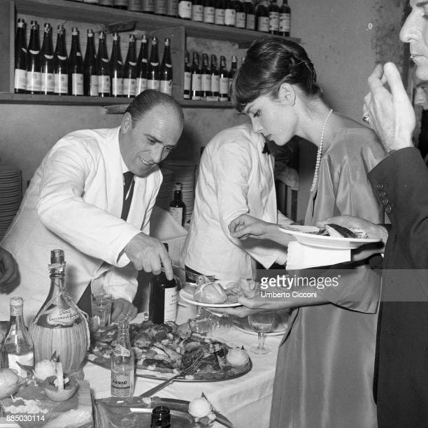Italian actress and fashion model Elsa Martinelli at the restaurant 'Rugantino' during a dinner party Rome 1958