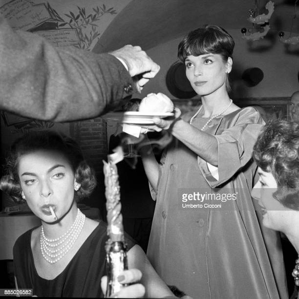 Italian actress and fashion model Elsa Martinelli is with Gaea Pallavicini at the restaurant 'Rugantino' during a dinner party Rome 1958