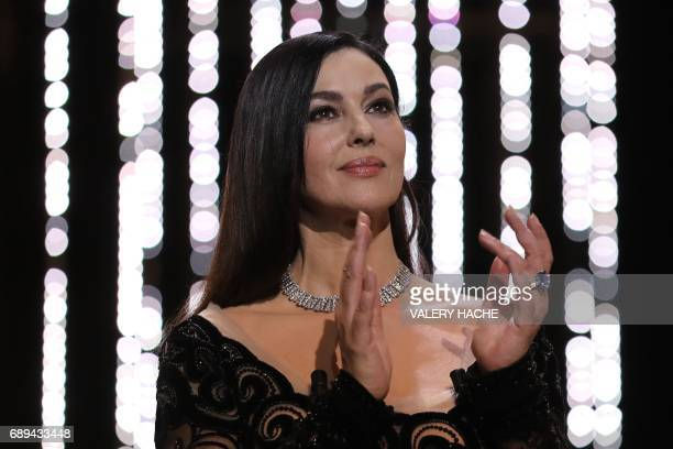 Italian actress and master of ceremonies Monica Bellucci applauds on stage on May 28 2017 during the closing ceremony of the 70th edition of the...