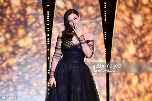 Italian actress and master of ceremonies Monica Bellucci blows kisses as she arrives on stage on May 17 2017 during of the opening ceremony of the...