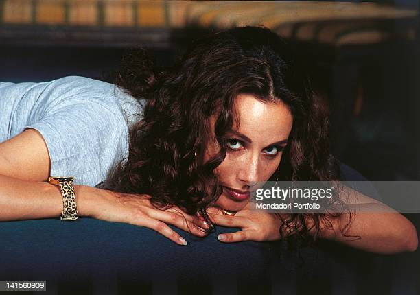Italian actress and Miss Italy in 1977 Anna Kanakis lying on a sofa. 1996
