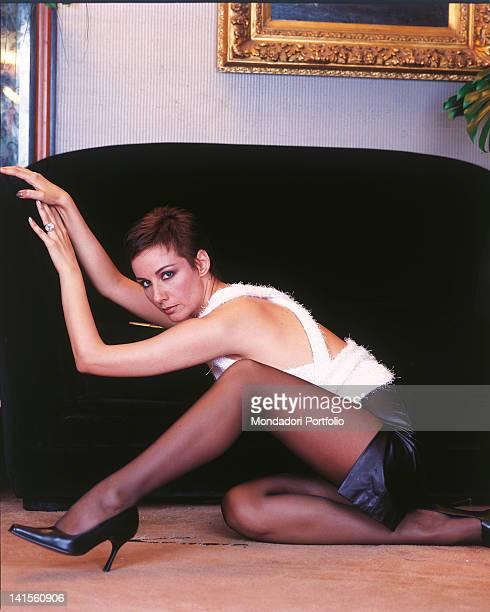 Italian actress and Miss Italy in 1977 Anna Kanakis next to sofa 1999