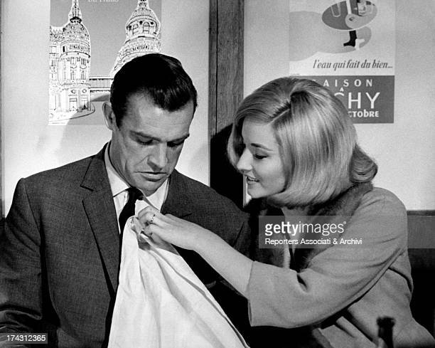 Italian actress and model Daniela Bianchi putting on a napskin as a bib to Scottish actor Sean Connery in the film From Russia with Love London 1963