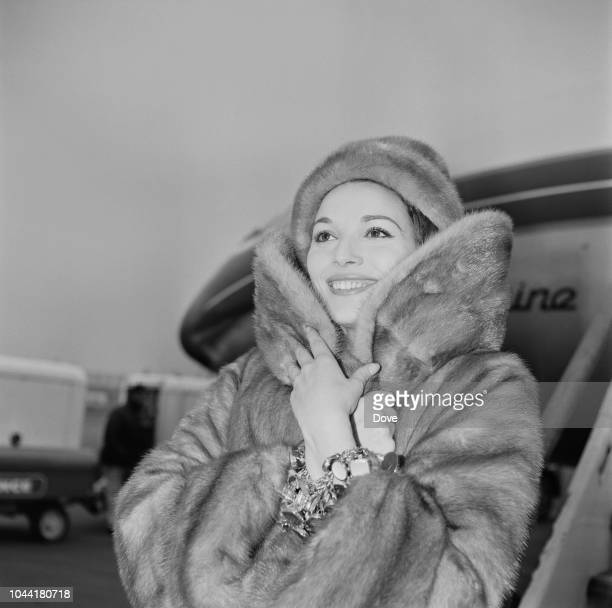 Italian actress and model Elsa Martinelli pictured wearing a fur coat as she arrives at London airport on 18th February 1963 Elsa Martinelli is in...