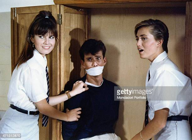 Italian actress and model Federica Moro smiling near Italian actor Christian Vadim muzzled in a cupboard in the film College 1984