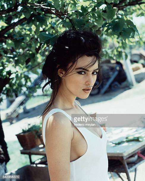 Italian actress and model Monica Bellucci at home in Rome, 6th June 1991.